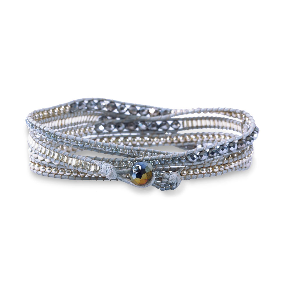 A Wrap Bracelet Made Of Various Silver Tone Sparkling Beads And Leather Sure To Match Any Outfit